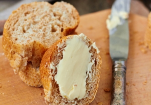 Sliced baguette with butter